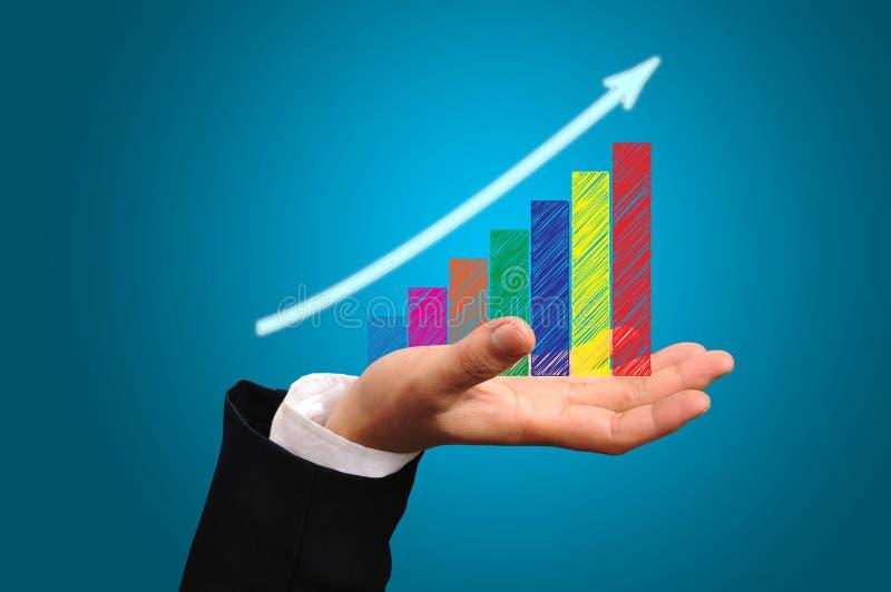 Biznesowy Wzrostowy wykres na Męskiej ręce zdjęcie royalty free