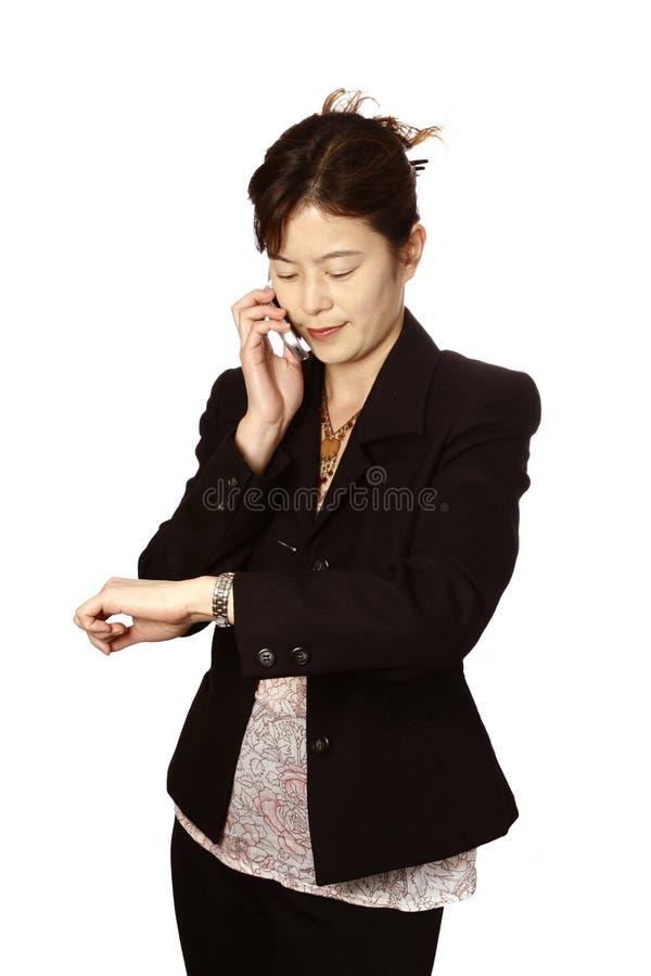 bizneswoman jej japoński telefon komórkowy fotografia stock