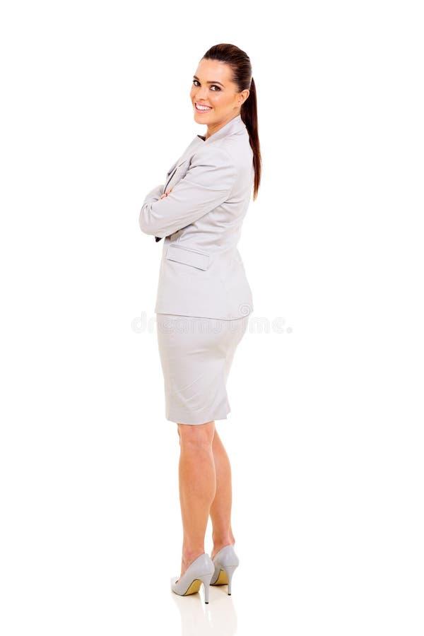 Bizneswoman przyglądający z powrotem obraz stock