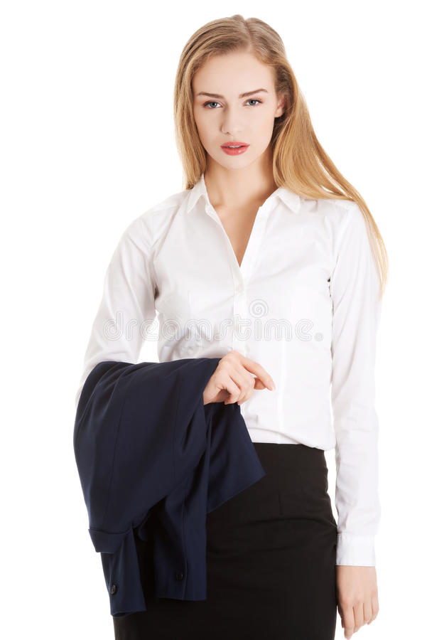 Bizneswoman trzyma jej kurtkę zdjęcia royalty free