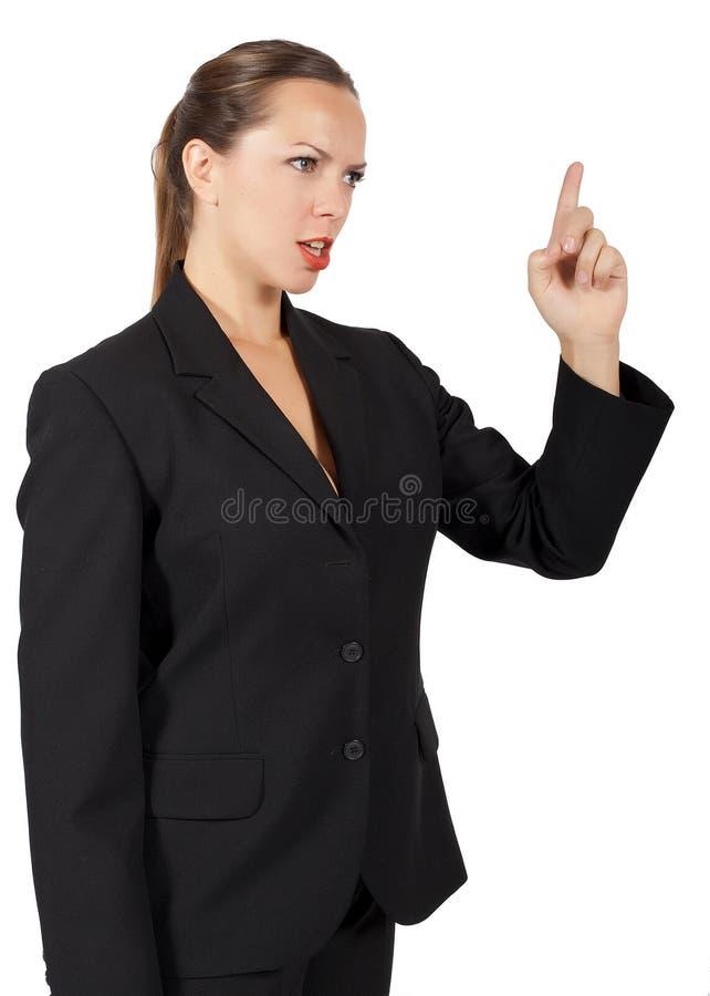 Bizneswoman trzyma up jej przyglądającego spęczenie i palec fotografia royalty free