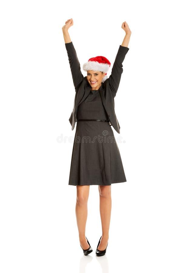 Bizneswoman w bożych narodzeniach kapeluszowych zdjęcia royalty free