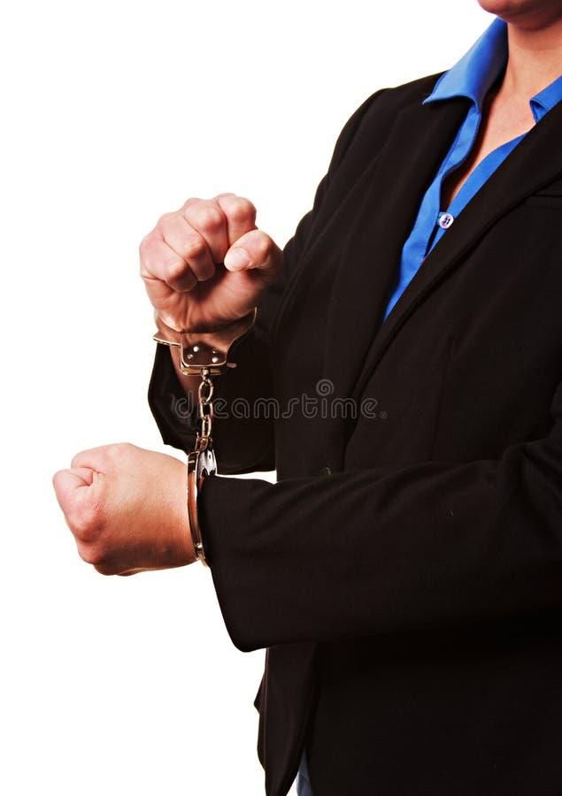 Bizneswoman w kajdankach odizolowywających na bielu obrazy royalty free