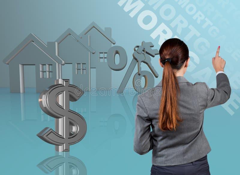 Bizneswoman w nieruchomości hipoteki pojęciu zdjęcie stock