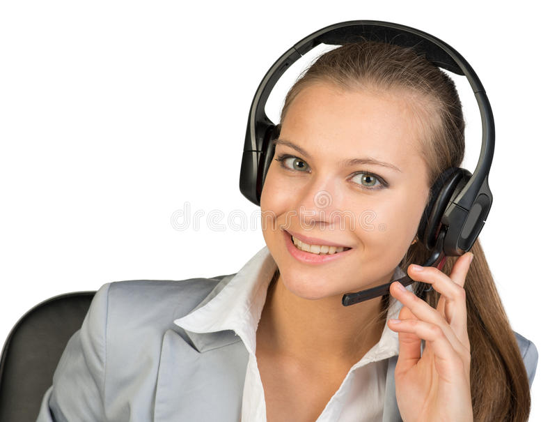 Bizneswoman w słuchawki, z jej palcami dalej obraz stock