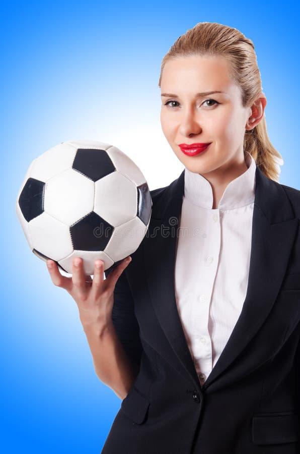 Bizneswoman z futbolem obraz royalty free