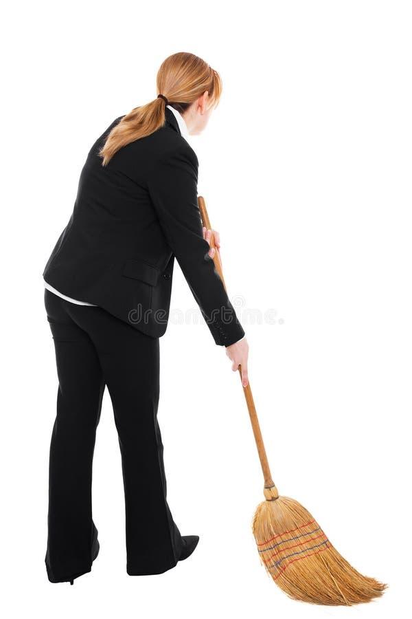 Bizneswoman z miotłą obraz stock