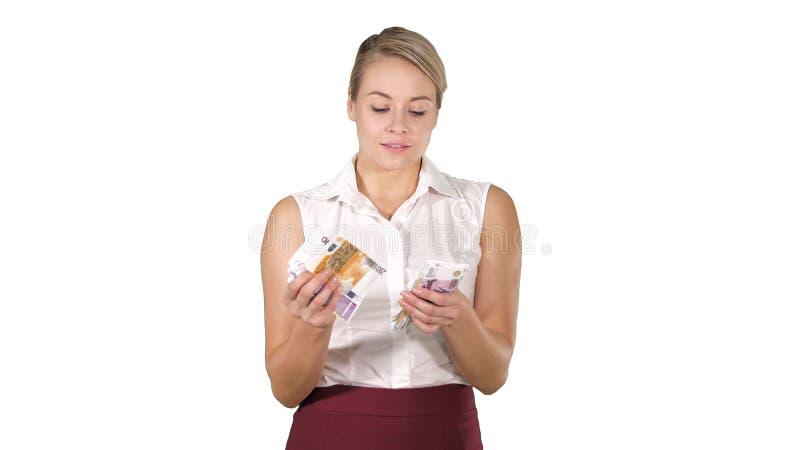 Bizneswoman z pieniądze liczy one na białym tle zdjęcie royalty free