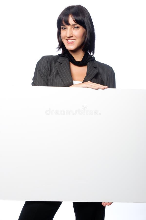 Bizneswoman z pustą kartą zdjęcie stock