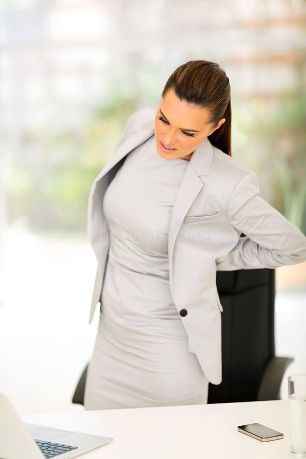 Bizneswomanu ból pleców obraz stock