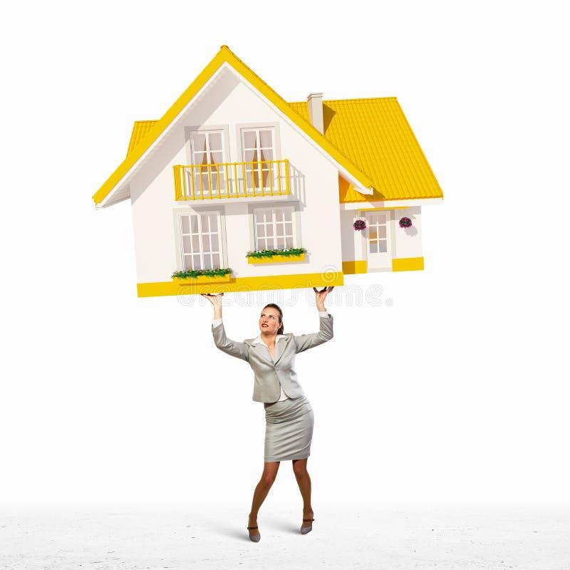 Bizneswomanu mienia model dom zdjęcia royalty free