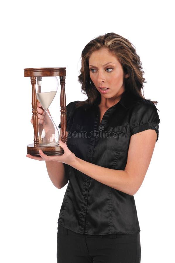 bizneswomanu mienia piaska zegar zdjęcie royalty free