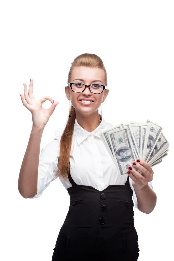 Bizneswomanu mienia pieniądze obrazy royalty free