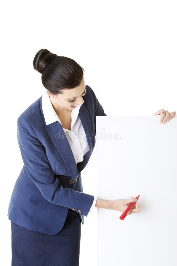 Bizneswomanu mienia pustego miejsca markier i deska. obraz stock