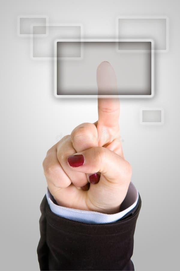 bizneswomanu palców naciskać przycisk fotografia stock