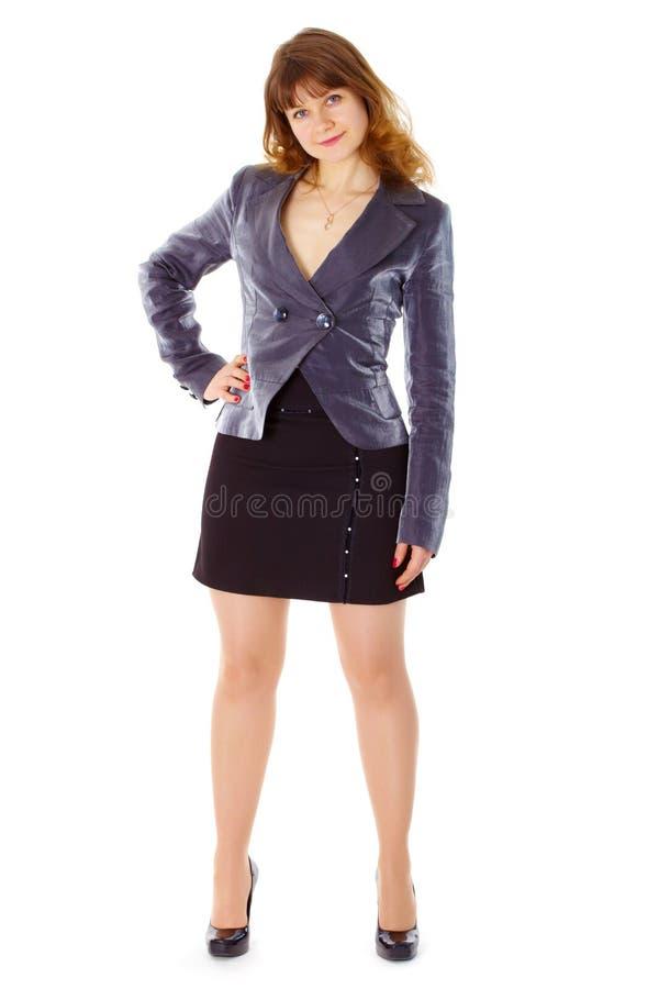 bizneswomanu postury niewywrotny trwanie biel zdjęcia stock