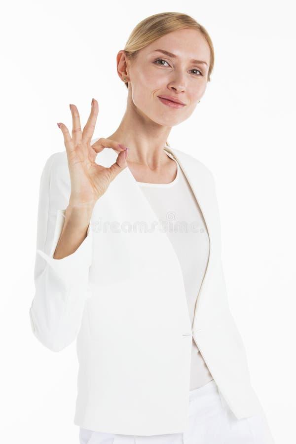 Bizneswomanu seansu ok ręki znak zdjęcia royalty free