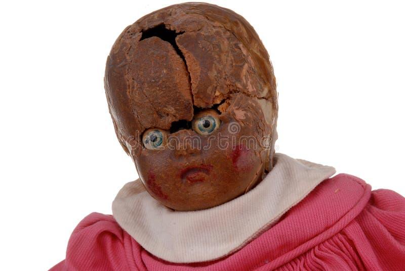 Bizzare vintage baby doll stock photo