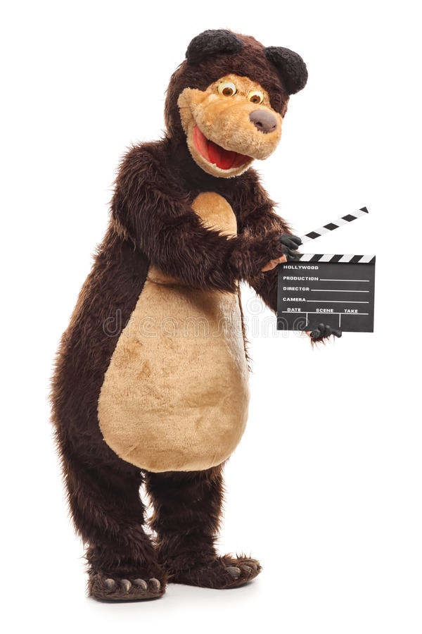 Björn som rymmer en clapperboard royaltyfria bilder