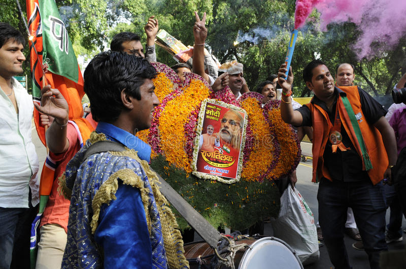 Bjp party workers celebrating during the election in India. NEW DELHI-MAY 16: BJP party workers dancing and singing after wining the Indian National election on royalty free stock photo