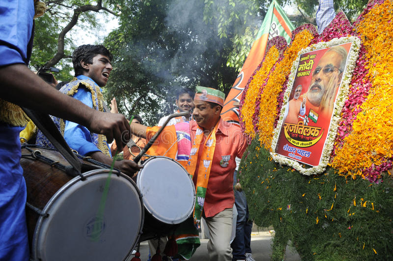 Bjp party workers celebrating during the election in India. NEW DELHI-MAY 16: BJP party workers dancing and singing after wining the Indian National election on royalty free stock images