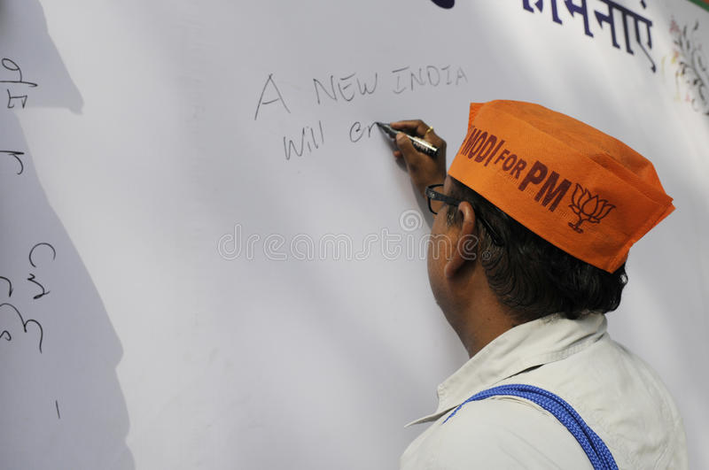 Bjp party workers celebrating during the election in India. NEW DELHI-MAY 16: A supporter writing messages on a message board after BJP won the Indian National royalty free stock images