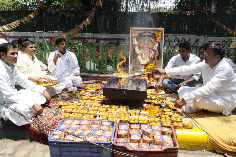 Bjp party workers celebrating during the election in India. NEW DELHI-MAY 16: BJP supporters doing puja or offering prayers to God after BJP won the Indian stock images