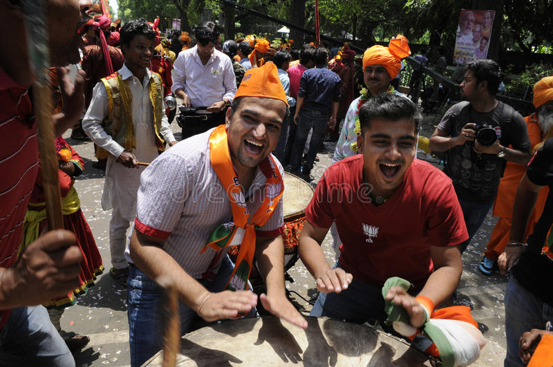 Bjp party workers celebrating during the election in India. NEW DELHI-MAY 16: BJP supporters playing drums in front of the party headquarter after BJP won the royalty free stock images