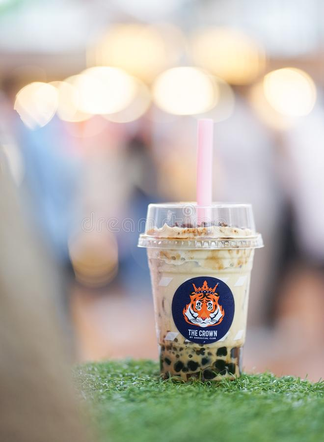 BKK - May 25, 2019 : a bubble milk tea from Fire Tiger by Seoulcial club , a popular cafe in Thailand most famous for its boba stock images