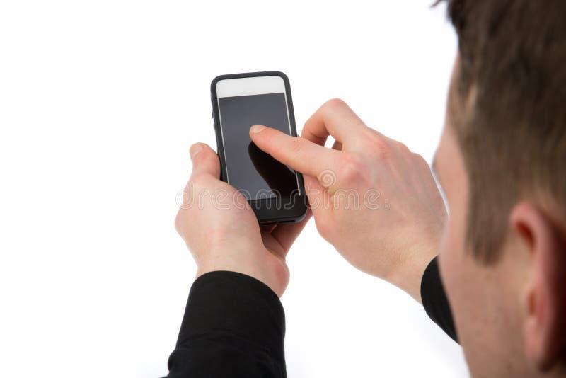 Bläddra på en telefon royaltyfria bilder