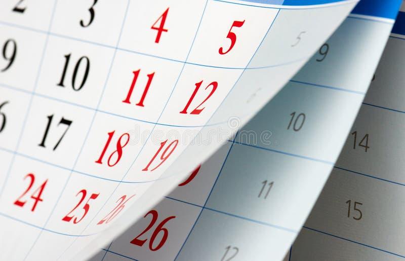Bläddring av två kalenderark royaltyfria bilder