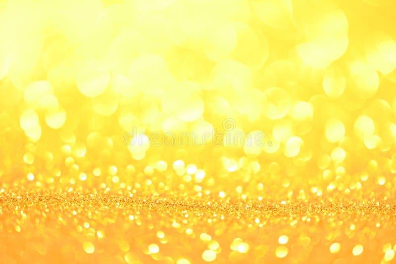 Blänka guld- bokeh Colorfull gjorde suddig abstrakt bakgrund för födelsedagen, årsdagen, bröllop arkivfoto