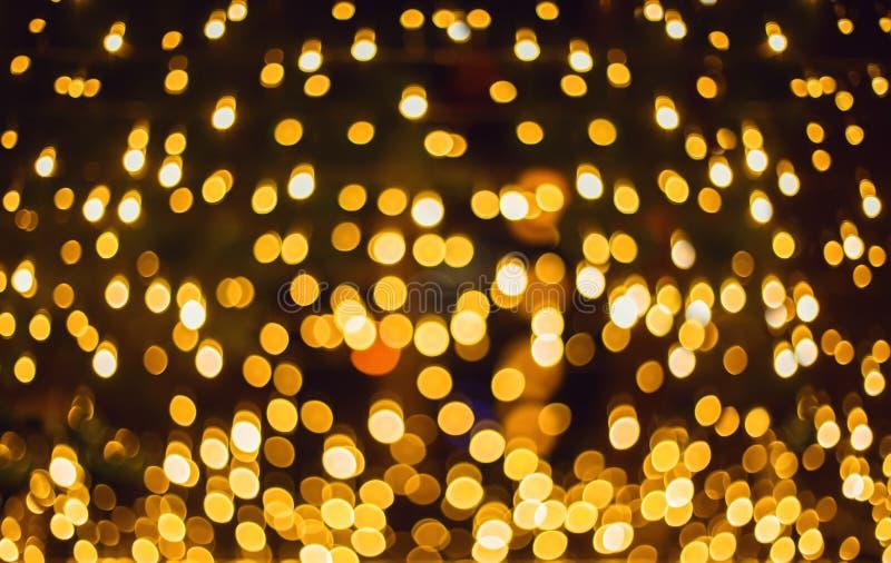Blänka lampabakgrund Feriebokehtextur mörk guld och svart royaltyfri foto