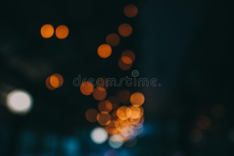 Blänka stjärnor på bokeh suddighet bakgrund arkivfoton