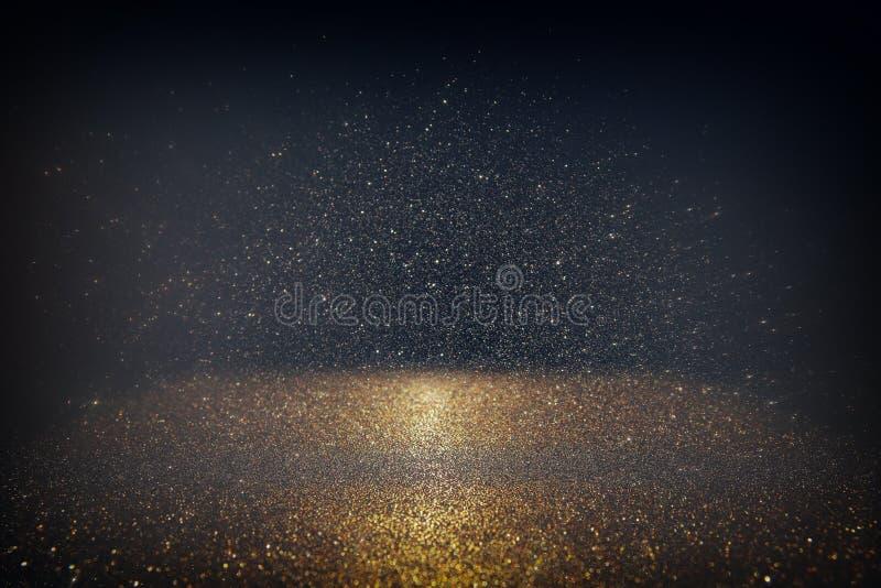 Blänka tappningljusbakgrund ljus silver, guld, svart defocused