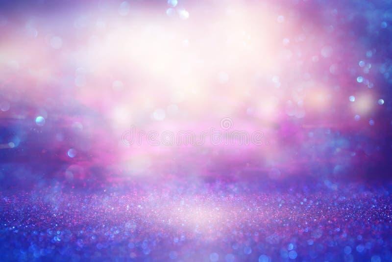 Blänka tappningljusbakgrund rosa purple de-fokuserat arkivbilder