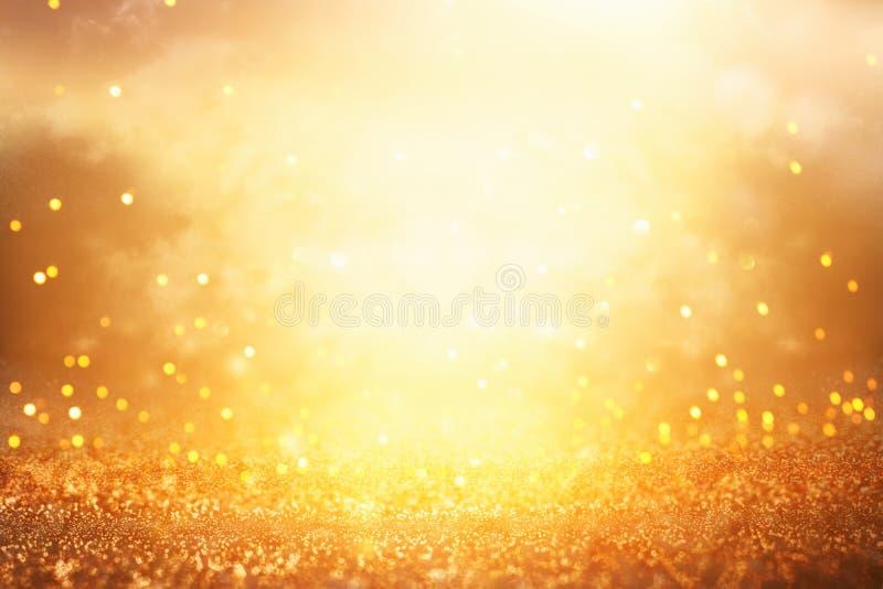 Blänka tappningljusbakgrund Silver och guld de-fokuserat arkivbild
