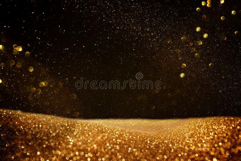 Blänka tappningljusbakgrund svart guld de-fokuserat stock illustrationer