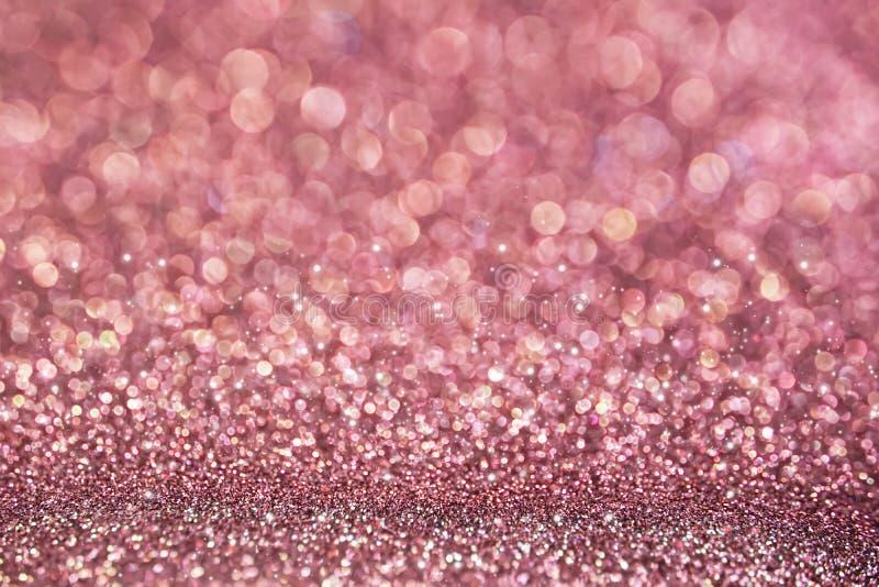 Blänker guld- rosa färger för suddighet texturbokehbakgrund arkivbild