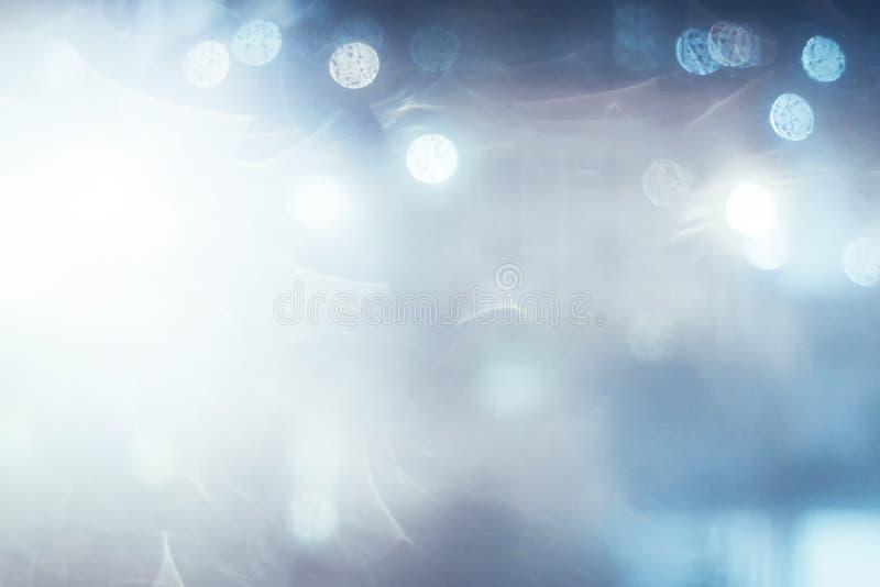 Blå abstrakt bakgrund för bokeh och för ljus arkivfoto
