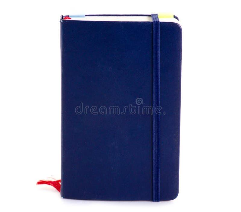 Blå anteckningsbokdagbok royaltyfria foton