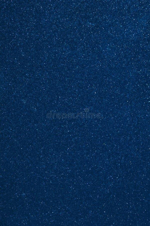 Blå bakgrund för skinande partiklar royaltyfria bilder