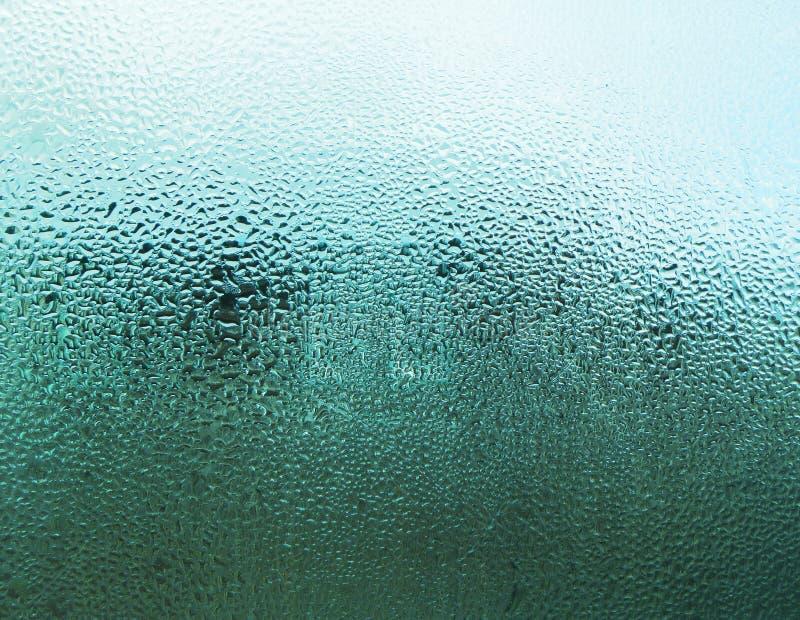 Blå bakgrund med каРÐΜÐ-¹ för ¿ Д av vatten arkivfoto