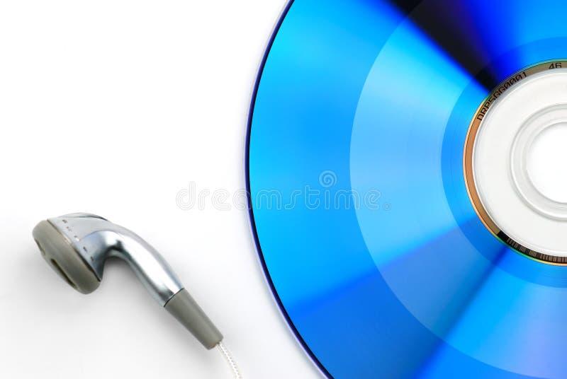 blå cd hörlur royaltyfri foto