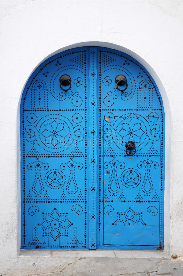 blå dörrväggwhite royaltyfria bilder
