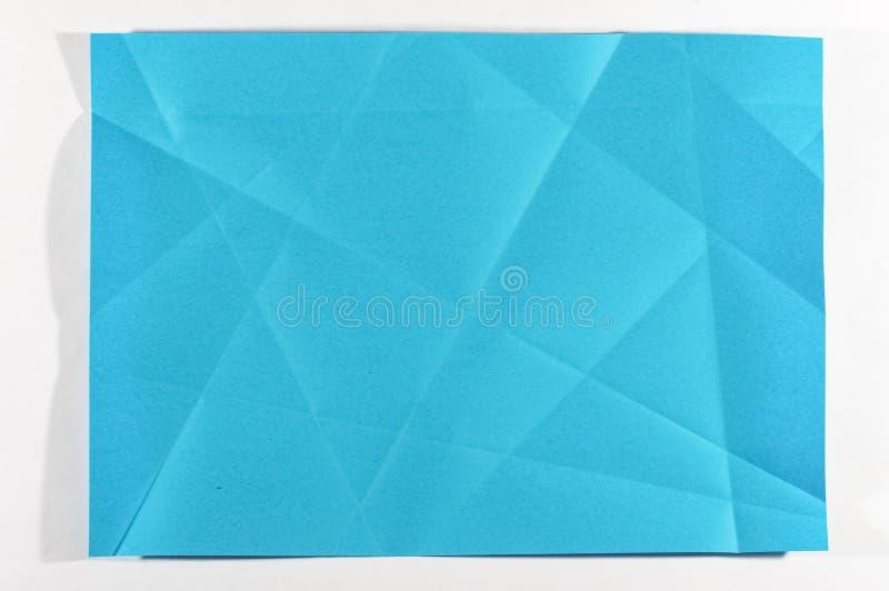 Blå färg vikt papper royaltyfri bild