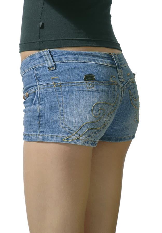 blå flicka isolerade kortslutningar för jeans short arkivbilder