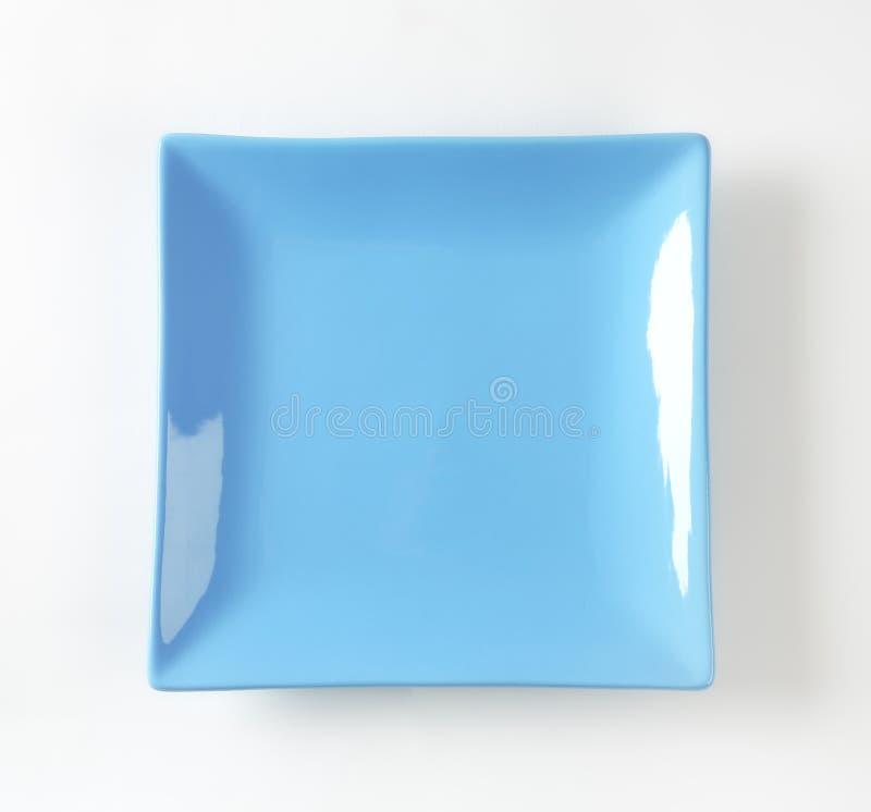 Blå fyrkantig platta royaltyfri fotografi
