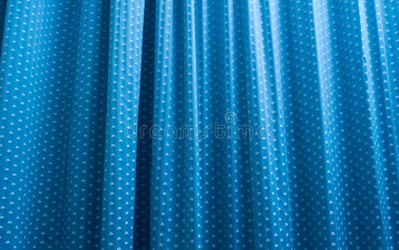 blå gardin för bakgrund arkivbild