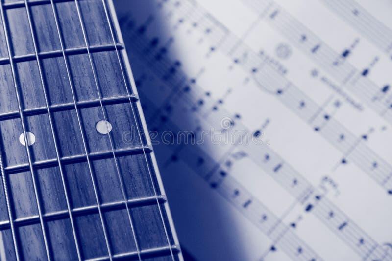 blå gitarrmusik fotografering för bildbyråer